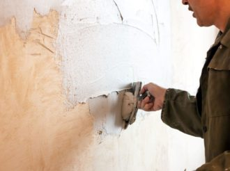 Man Plastering Drywall
